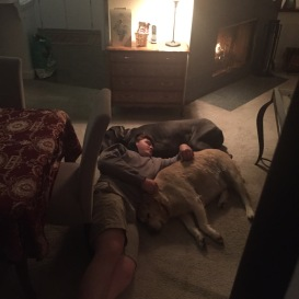 Mikey and Maxie relaxing with one of their favorite fans.